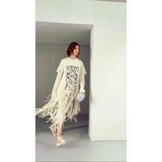 Almost Victorian in his approach - melded in with a modern body hugging silhouette that still speaks of an intellect and sensitivity thats wholly @jw_anderson - this seasons @loewe girl travels through time and space eras and continents for a complex mix of Past Present Future (we have our eyes on the super cool fringed logo tee! ) #pfw #ss18 #loewe #jwanderson - EIC @kennieboy gives u all the #frow action in Paris  via HARPER'S BAZAAR SINGAPORE MAGAZINE OFFICIAL INSTAGRAM - Fashion…