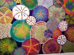 Sand Dollar Spectrum, a quilt by Betty Busby