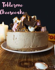 Easy No-Bake Milk Chocolate Toblerone Chocolate cheesecake, topped with Toblerone, nougat and salted caramel! The perfect recipe to use up Christmas chocolate