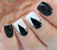 Black and white winter nail art. Give a twist to the classic black and white polishes by adding silver glitter polish on top. Source
