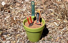 Self-Cleaning & Sharpening Garden Tool Holder:  Depending upon the number of hand tools, choose an appropriately sized terra-cotta pot or pots.  Spray paint (optional) and cover the drainage hole.  In a large bucket, mix sand and 20-30 ounces of mineral oil with a hand trowel until well mixed.  Fill the pot(s) and tamp down lightly. - onegoodthingbyjille.com