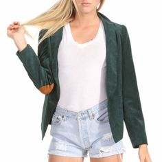 Look and feel studious in this corduroy blazer. Featuring raw faux leather elbow pads and narrow cut. Pair this with cutoffs and over sized bag!