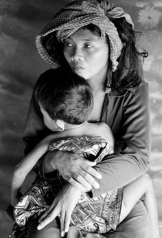 A Cambodian refugee with her child at the Ban Mai Rut refugee camp near Klong Yai, Thailand. There are about 5,200 refugees in this camp which has a permanent wooden structure and several new ones made of bamboo poles and thatched roofs and walls.