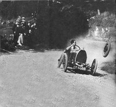 I know this really shouldn't be funny but the drivers face as he is looking at his tire passing him almost seems cartoon like!   BUGATTI TYPE 13 1920