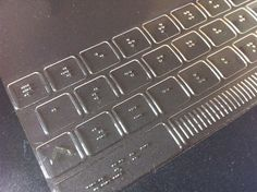 Braille keyboard for iPad. Printed on static cling plastic.