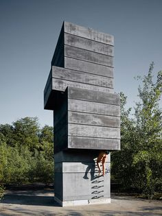 Not your grandpa's sauna. The One Man Sauna stands on an abandoned factory site in Bochum, Germany. The Modulorbeat design is a stacked tower of concrete shaft mine components. Architecture Design, German Architecture, Minimalist Architecture, Classical Architecture, Contemporary Architecture, Saunas, Tower House, Small Buildings, Dezeen