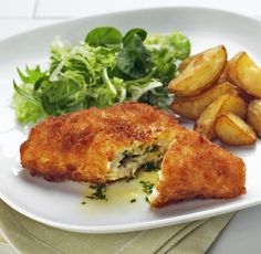 Golden-browned chicken breast stuffed with garlic butter and herbs. - (My Mom used to make Chicken Kiev, and I need to try making it now! This looks so good!) - C