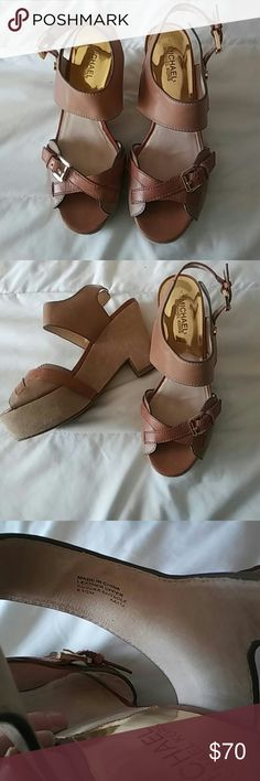 ❤LOWEST❤Michael Kors   Tan & Gold Wedges Great condition Michael Kors Leather wedges. They have some minor wear (pictured) on the back bottom of the heel part, one of the toe parts, and the bottom of the shoe. These heels are tan with shiny gold details.  Please make me a reasonable offer! I would love to sell these! MICHAEL Michael Kors Shoes Wedges