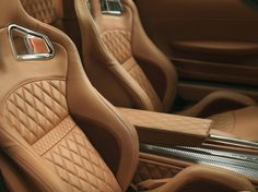 Spyker uses high-end leather, aluminum and aero-styled controls to create a unique look