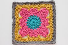 """Pattern: #189 Chocolate Box from 200 Crochet Blocks for blankets, throws, and afghans by Jan Eaton Hook used: H Finished Size: 8"""" Colors Used: I love this yarn's Grey Beard, Sungold, hot rose and peacock. I love this square! However, this was one of those patterns that I was not..."""