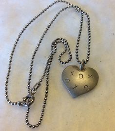 A personal favorite from my Etsy shop https://www.etsy.com/listing/250002199/sterling-silver-xs-and-os-heart-shaped