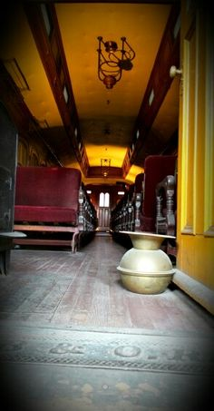 B&O Railroad Museum passenger car vintage reds and yellows dark woods