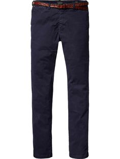 Scotch & Soda Denim Navy Stuart Chinos: The Scotch & Soda Stuart is our regular slim fit chino. Essential to any man's wardrobe, these basic stretch cotton chinos come delivered with a leather belt. Featuring a slim fit, zip fly, two side pockets, two welted back pockets, garment dyed fabric and belt.