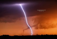 On 5/25/2012, my partner and I had chased a blob of storms, each with embedded supercells throughout central KS. After sunset, a tornado touched down near Hays, KS, and proceeded to rope out in spectacular fashion. More spectacular: clear channel lightning dropped in the frame creating a criss-cross. f/10, 6 sec exposure, ISO 100, 135mm