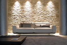Smart sofa - sitting on bronze or steel finished feet, the base platform is covered in leather or upholstered in fabric, adding another layer of elegance to the graceful shape of the sofa. #HPmkt GYFORM 220 Elm #301