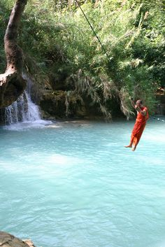 This looks fun! Swing on a rope and jump into the crystal clear water in Luang Prabang, Laos. #monogramsvacation