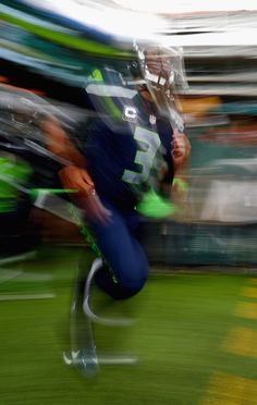 Russell Wilson Photos Photos - Quarterback Russell Wilson #3 of the Seattle Seahawks runs onto the field before the game against the New York Jets at MetLife Stadium on October 2, 2016 in East Rutherford, New Jersey. - Seattle Seahawks v New York Jets