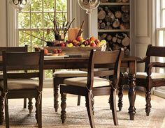 Stain table and chairs this color and make lighter colored seat cushions.