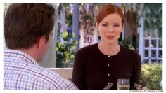 Bree Van De Kamp Wisteria Lane park garden outside neighborhood black cardigan pearl button earrings matching pearls white classy closeup 3/4 sleeves watch jewels tight fitting round neck elegant desperate housewives season 2 outfit fashion style clothes widow with george
