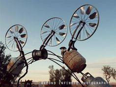 Bicycle Wheel Windmills and Garbage Gateways - Trash to Treasure Sculpture 8x10 Photo (Other print sizes available) - rust bike wind mill via Etsy
