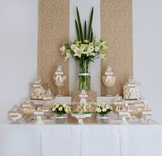 love the use of flowers on the dessert table.