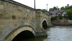 """Picture of bridge over the River Arun at Arundel, downstream from the bridge was the """"port"""" of Arundel, which was accessed from the sea, and, in former times, by canal. Upstream, the River Arun was formerly linked to the River Wey by the Wey and Arun canal."""