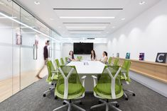Cossette Offices – Vancouver. Meeting room. Green chairs