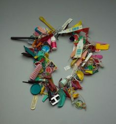 Robert Ebendorf necklace, 1992. Plastic, found objects, metal.