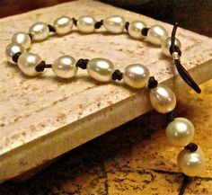 Freshwater Pearl and Brown Leather Cord by CarmellasJewelry, $27.50 find glass pearls at http://www.ecrafty.com/c-595-glass-pearls.aspx