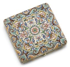 A SILVER-GILT AND CLOISONNÉ ENAMEL CIGARETTE CASE, FEODOR RÜCKERT, MOSCOW, 1899-1908 square, the surface with shaded formal flowers and leaf scrolls surrounding a central rosette on vari-coloured grounds, 88 standard  width: 8.9cm, 3 1/2 in.