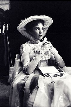 """Julie Andrews takes a break in filming the """"Jolly Holiday"""" scene of Mary…"""