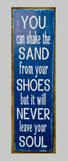 """Welcome and we are glad you stopped by! Hand Painted Beach Décor Beach Signs, Beach House Décor, Coastal Cottage Rustic Décor.  All 100% Hand Painted.    You Can Shake The Sand From Your Shoes But It Will Never Leave Your Soul Sign    In my shop you will find hand painted wood signs with great care and love.  Please let us know if you need any help. All signs are painted on the back and a hanger put on before shipping.    Size of sign 22"""" x 7""""    Colors are navy blue and white.    Have a ..."""