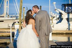 A casual portrait of the bride and groom at the water over looking Long Island Sound. Pictures and images of a Mamaroneck Beach and Yacht Club Wedding captured by Peter Oberc Photography.