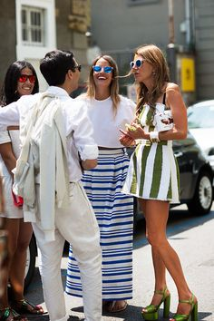 Italian fashionistas rocking the perfect casual-chic summer look in Milan, Italy