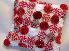 Peppermint candy pillow using fabric yoyo appliques. Talents of YoYoCottage, for sale on Etsy.