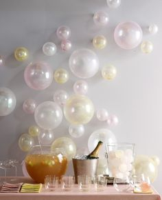 Bubbles ~ Decorate the Champagne bar or water party with balloons made to look like bubbles.