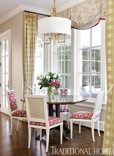 "Traditional Home on Twitter: ""#PinoftheDay: Cheery pink and green fabrics brighten the dining spot near the kitchen with views to the porch. https://t.co/LenLkteou3"""