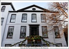 Holiday garland on step railings and wreaths on the first floor windows of an 18th century Georgian style house • Prince George Street in Annapolis Maryland. Photograph published on December 23rd 2015. To see a full size version of this photo show and the Annapolis Experience Blog article click on the Visit Site button. Images and article Copyright © 2015 G J Gibson Photography LLC.