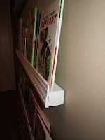 Forward Facing Bookshelves made with baseboard trim---awesome! Or lift? Craft Projects For Kids, Diy Projects, Photo Ledge, Baseboard Trim, Glossy Paint, Display Shelves, Storage Shelving, Wood Screws, Photo Displays