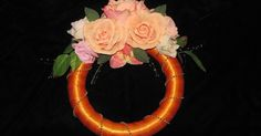 Simple yet beautiful floral wreath wrapped with wide satin ribbon and gold fused pearls strands.