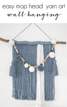 blue and white mop head yarn wall hanging