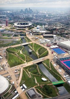 London 2012 Olympic Park:The north park consists of picturesque sculpted landforms and wild river banks, while the south is a harder world of entertainment plazas and towpath edges. Photo: Anthony Charlton/ODA