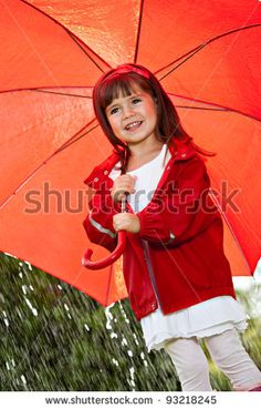 portrait of a little girl with umbrella by Val Thoermer, via Shutterstock