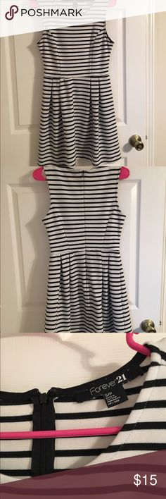 Black and White Striped Fit and Flare Dress Super cute, only worn a few times. No stains or rips. Small area of fabric piling along the underarms (shown in 4th pic) but not visible when wearing. Material is thicker and stretchy sort of like ponte Forever 21 Dresses Mini