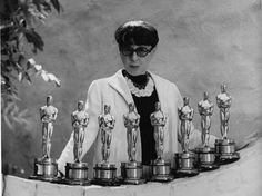 "Costume designer Edith Head (1897 – 1981) with her eight Academy Awards.  it's often said ""Gowns by Edith Head"" is one of the most noted screen credits in movie history (a record of 1100 films).""I have yet to see one completely unspoiled star, except for Lassie.""  Edith Head"