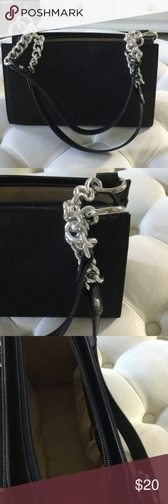Beautiful black handbag This bag is a beauty!  Sophisticated bag with silver accent chain.  Nice compartments inside.  Never used! Excellent condition! Bags Shoulder Bags