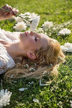 Stock photo of Beautiful blonde woman lying on green grass and smelling white flowers by JovoJVNVC Girl Photography Poses, Creative Photography, Fashion Photography, Foto Fantasy, Smelling Flowers, Shotting Photo, Mode Editorials, Poses Photo, Foto Pose