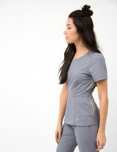The Peplum Top in Graphite is a contemporary addition to women's medical scrub outfits. Shop Jaanuu for scrubs, lab coats and other medical apparel. Vet Scrubs, Medical Scrubs, Doctor Scrubs, Scrubs Outfit, Scrubs Uniform, Jaanuu Scrubs, Stylish Scrubs, Medical Uniforms, Womens Scrubs