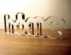 laser cut acrylic table #'s in black - cool idea in gold for the table numbers