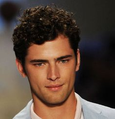 Fashionable men curly hairstyle in short length.PNG
